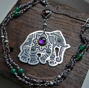 Sterling silver and gemstone raven pendant