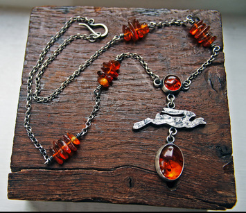 Silver and amber hare necklace