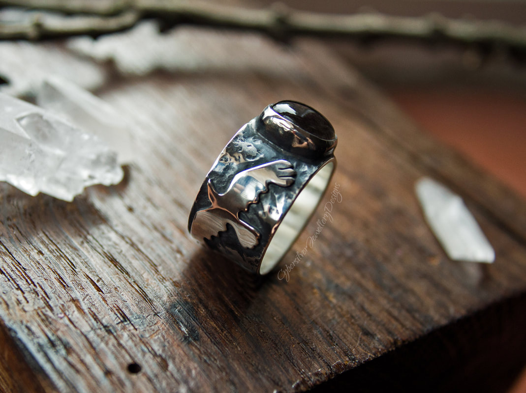 Silver foxes and amber ring
