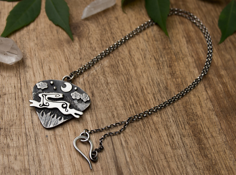 Silver leaping hare necklace