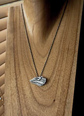 Silver badger face necklace