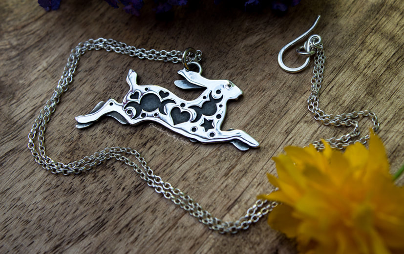 Leaping hare silver necklace with triple moons