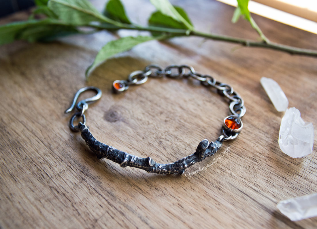Silver twig bracelet with amber