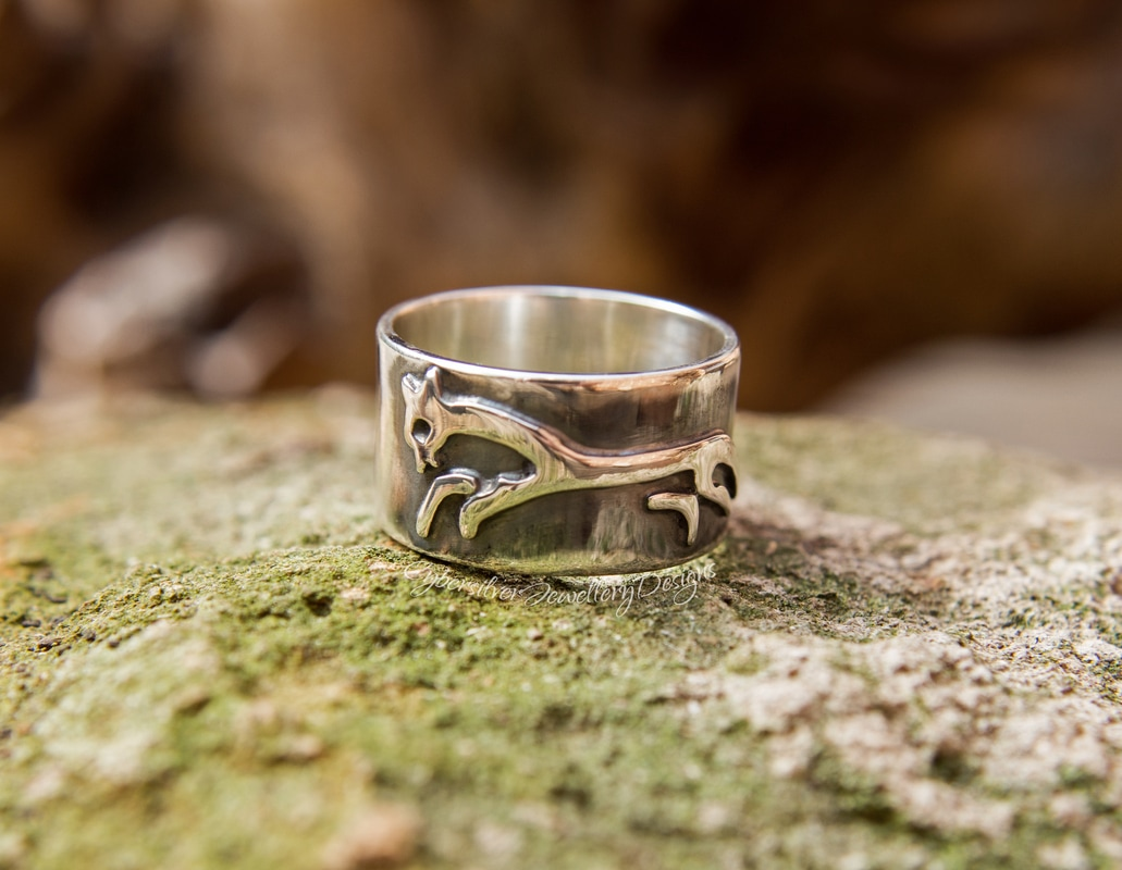 Silver celtic white horse ring with sun